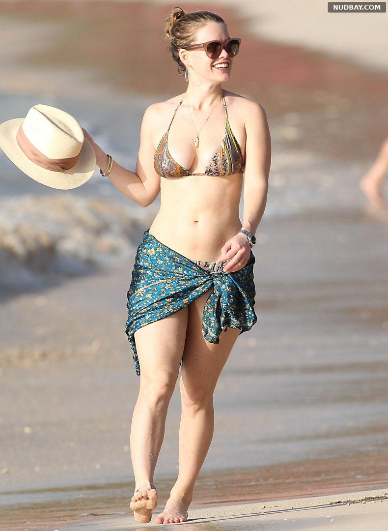 Alice Eve wearing a bikini at a beach in Barbados