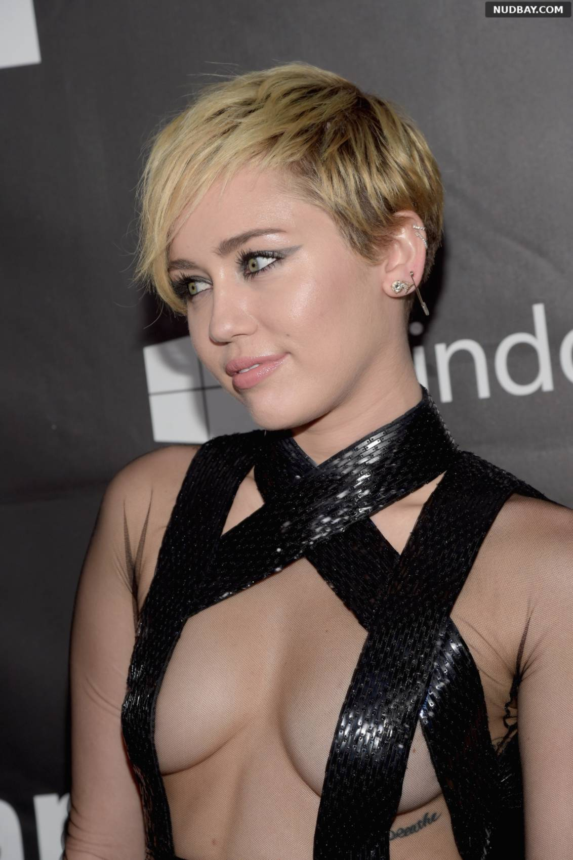Miley Cyrus attends the 2014 amfAR LA Inspiration Gala at Milk Studios on October 29, 2014 in Hollywood