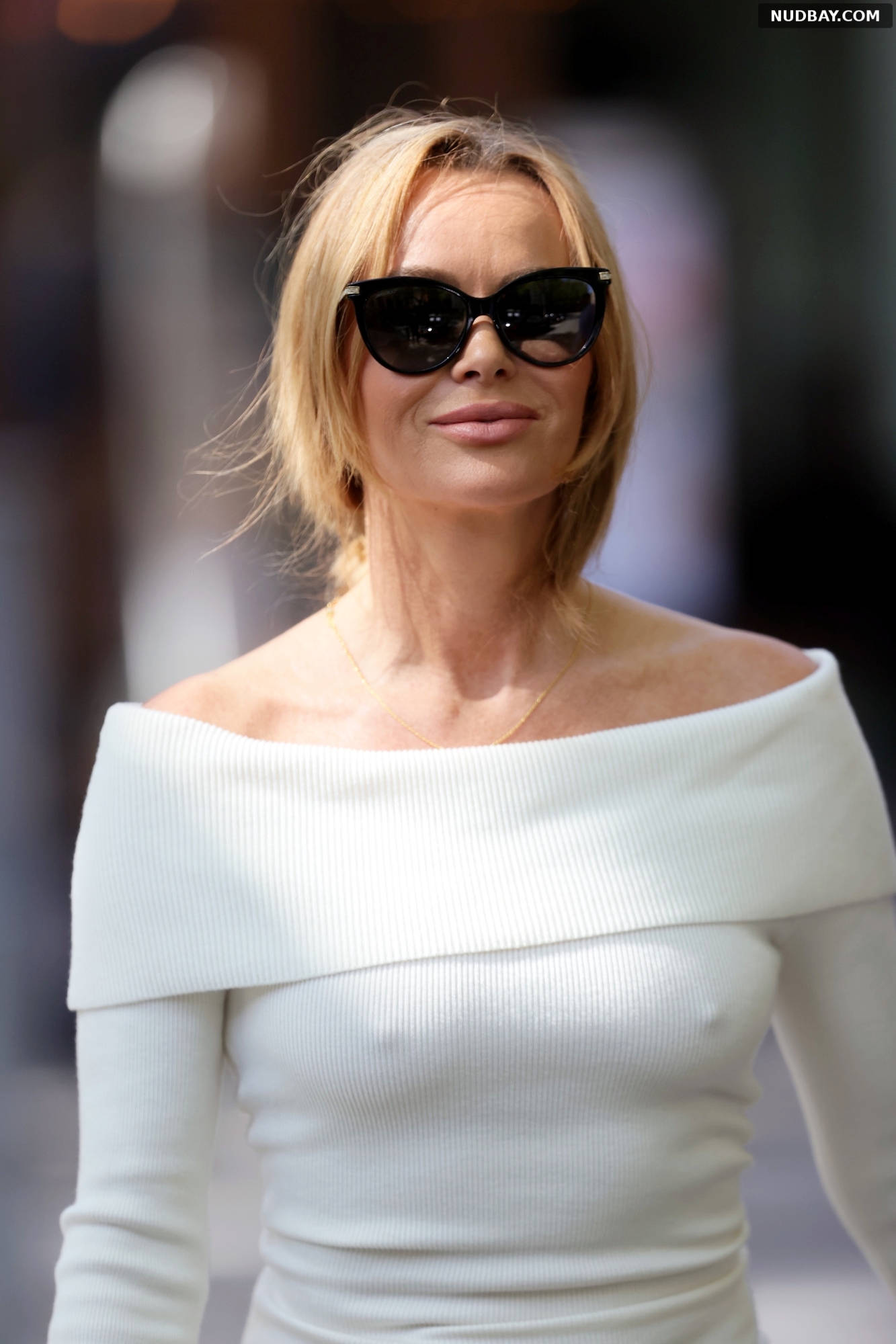 Amanda Holden in a white tight dress at Heart radio in London May 19 2021
