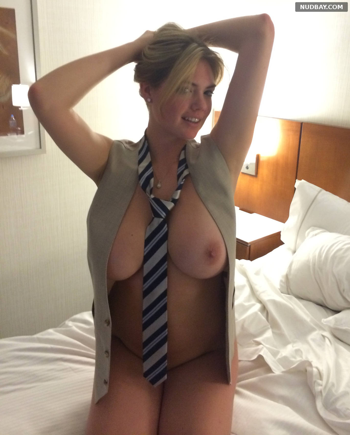 Kate Upton naked on the bed in a tie