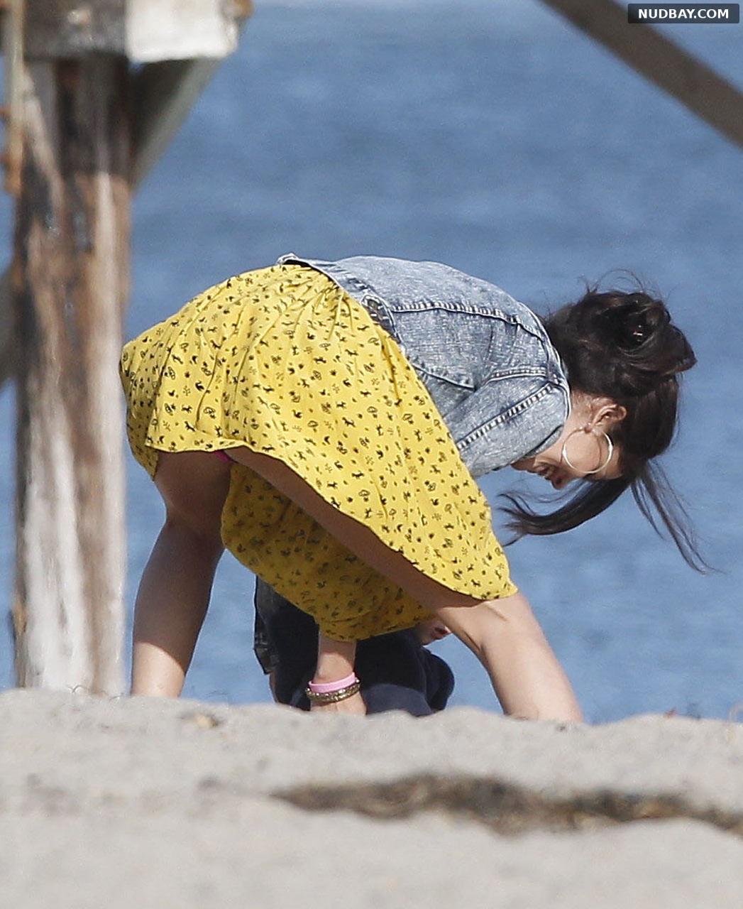 Selena Gomez upskirt on the beach Feb 17 2012
